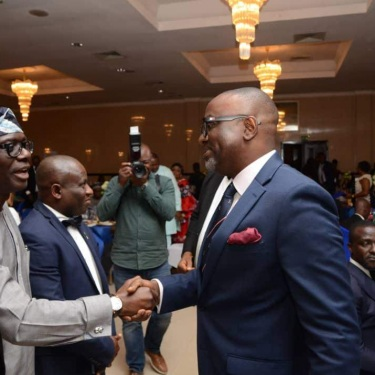 Gbenga Olaniyan with the Governor of Lagos State, Mr. Babajide Sanwo-Olu at the Nigerian Institution of Estate Surveyors and Valuers 13th Honours Night Awards 2019